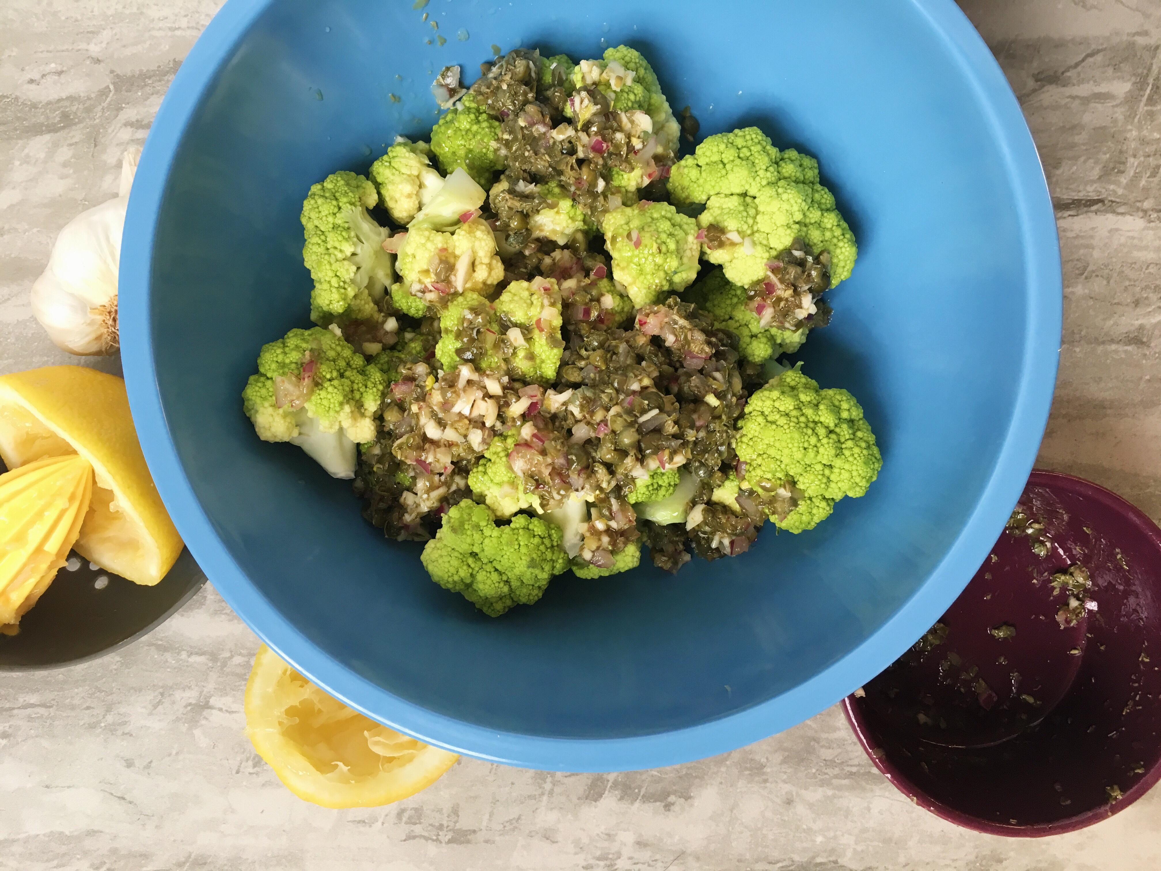 Green cauliflower marinating in sauce