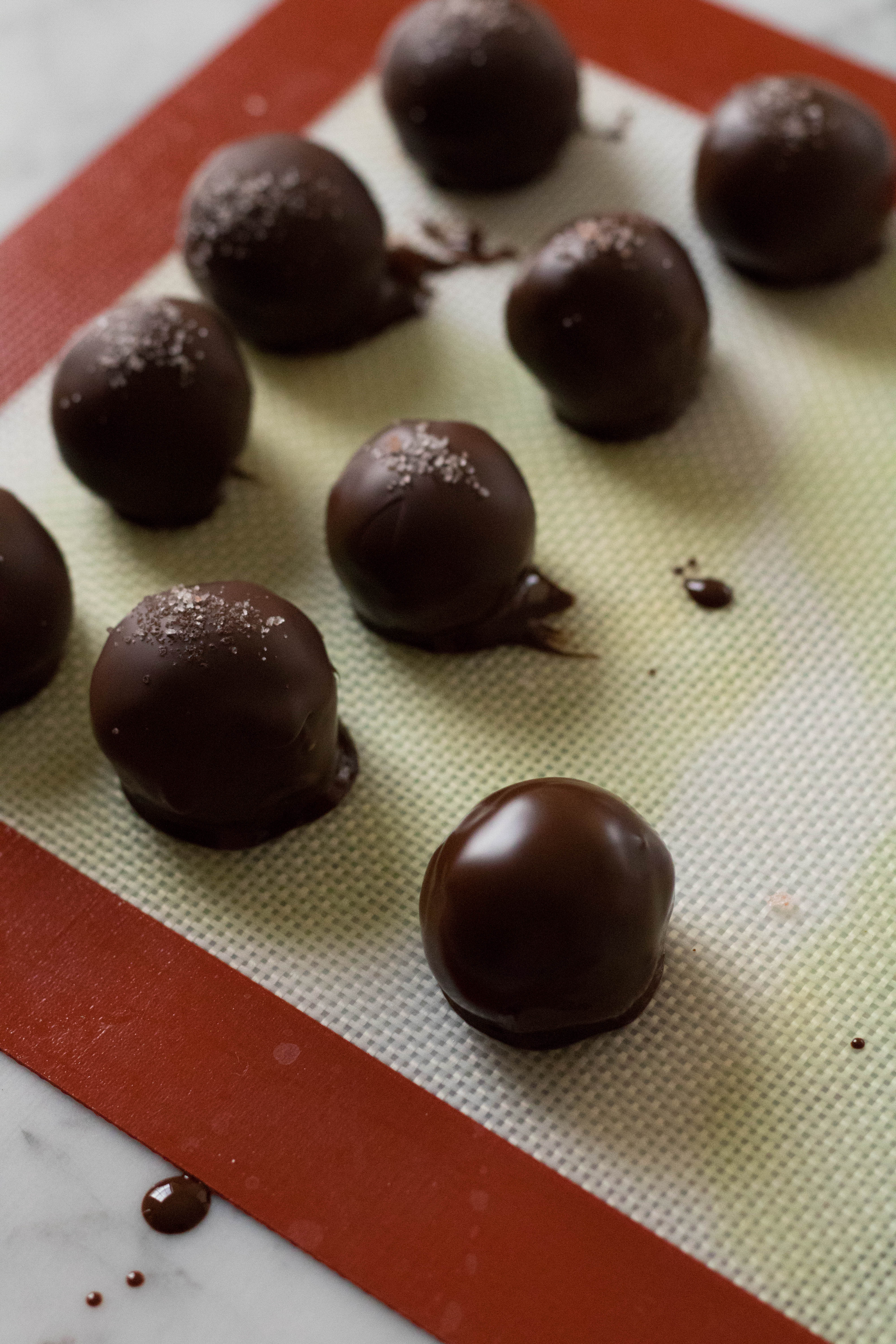 wanna be cookie dough chocolate covered balls with dates