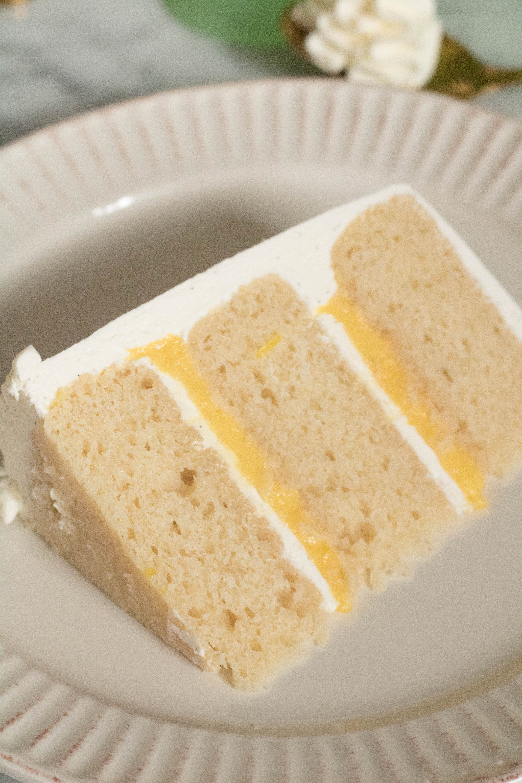 layered vanilla cake with lemon curd and vanilla bean italian meringue buttercream