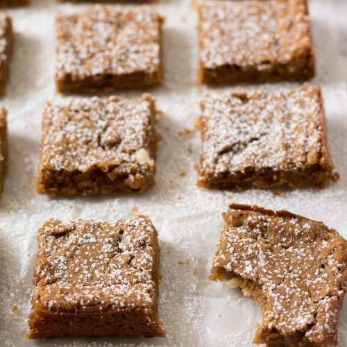 Chickpea pumpkin blondies squares with powdered sugar