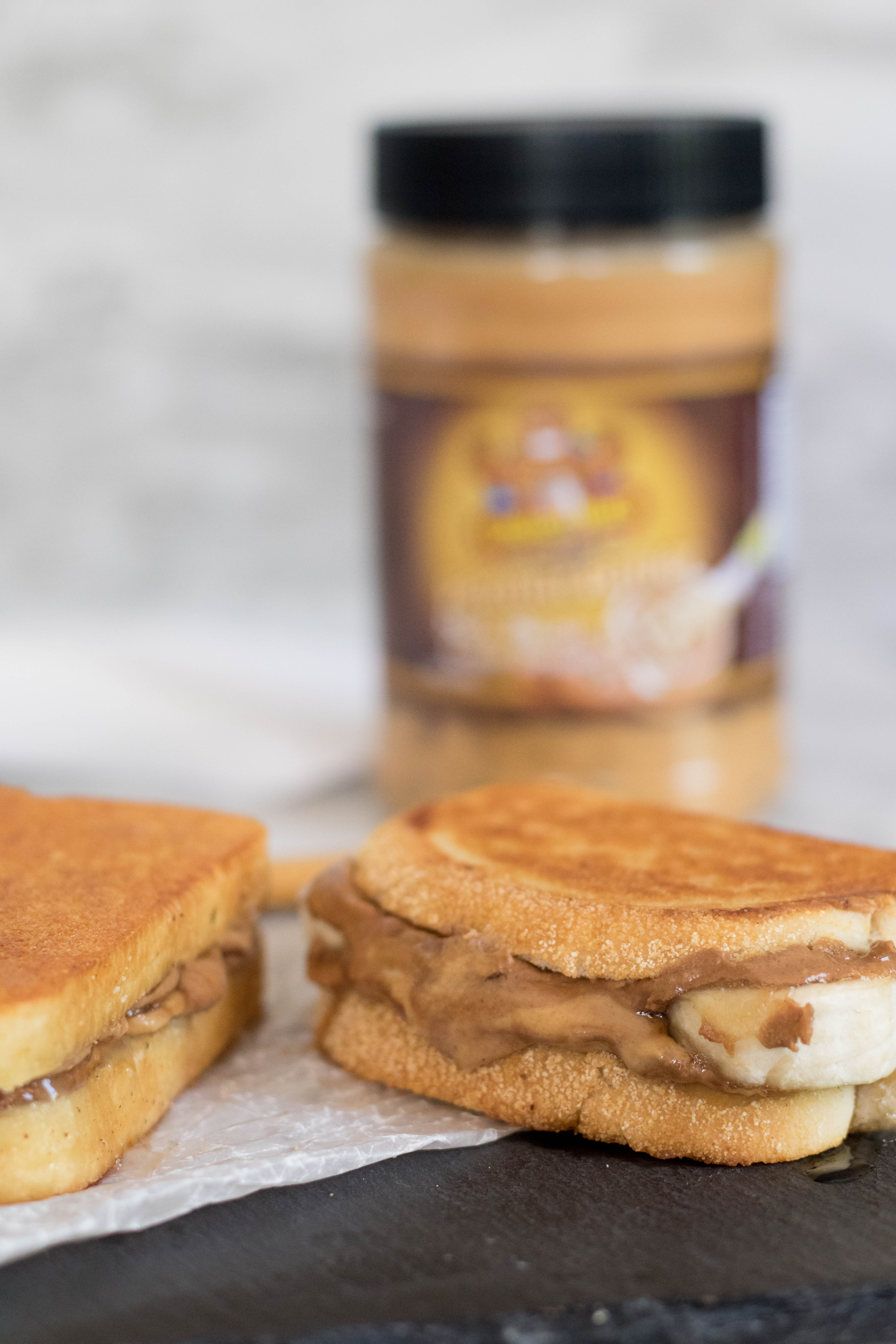 Peanut butter oozing out of the grilled banana Pb sandwich