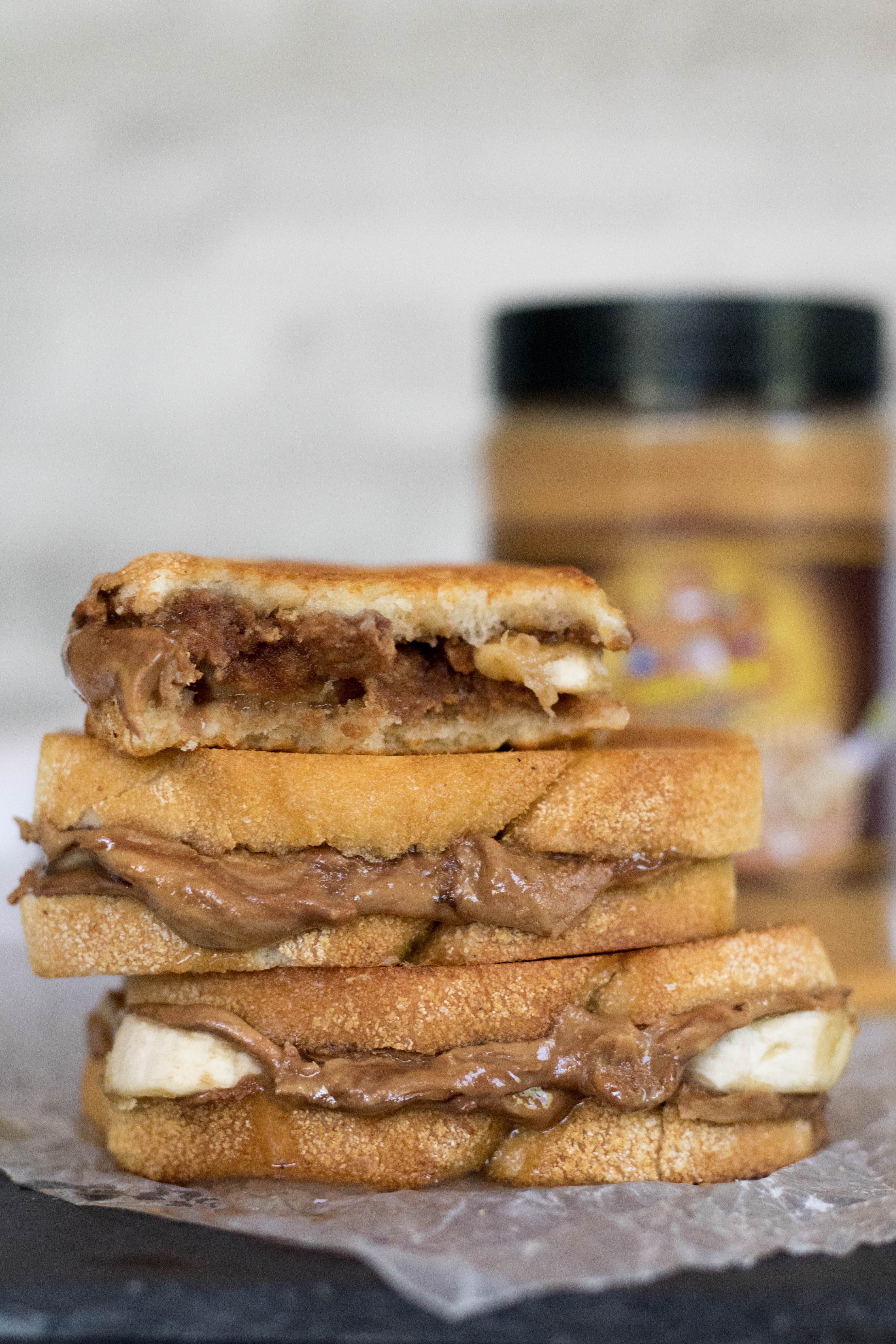 Grilled peanut butter banana sandwich cut in half to show the inside