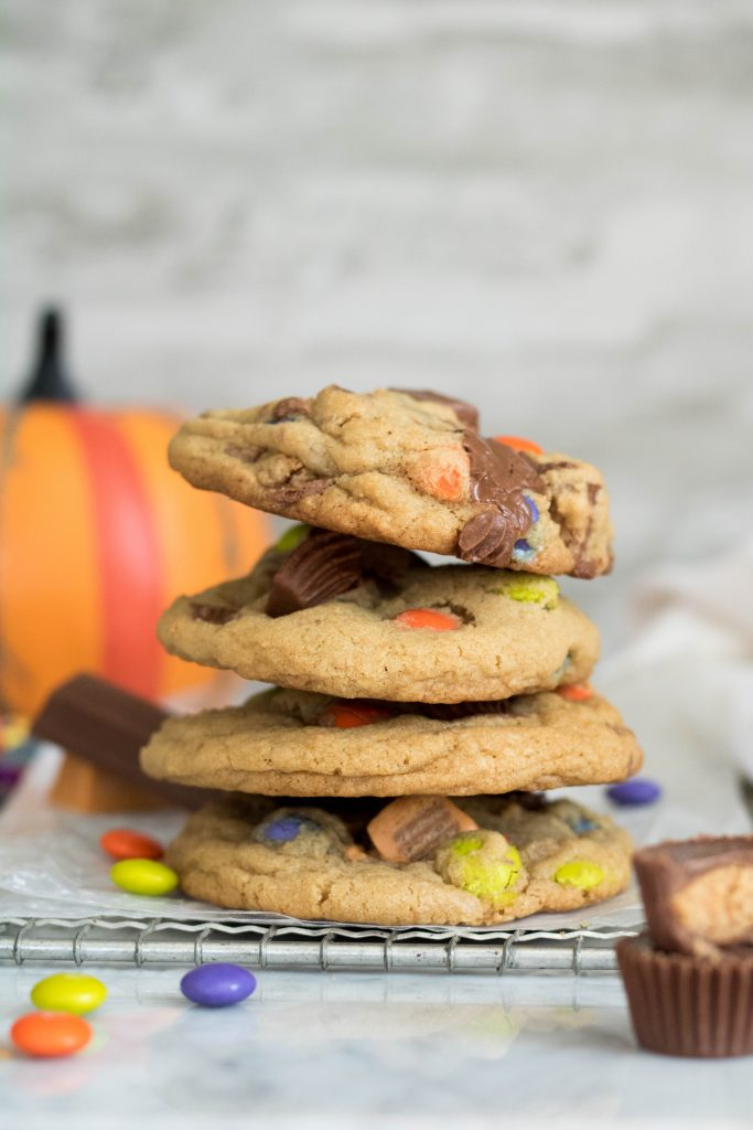 four cookies stacked on each other with candies on the forefront