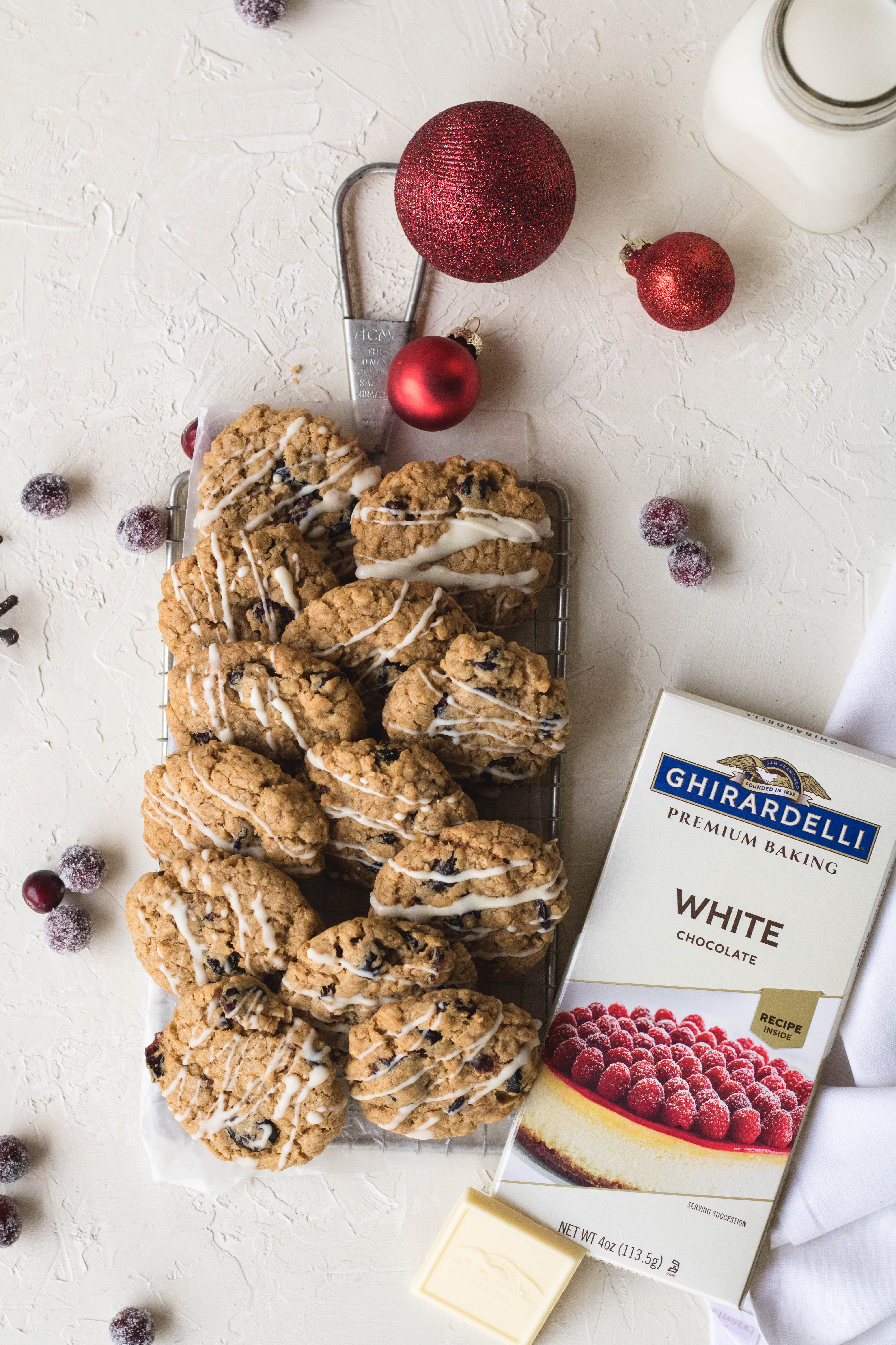 Festile oatmeal and cranberry cookies with ghirardelli white chocolate drizzled on top