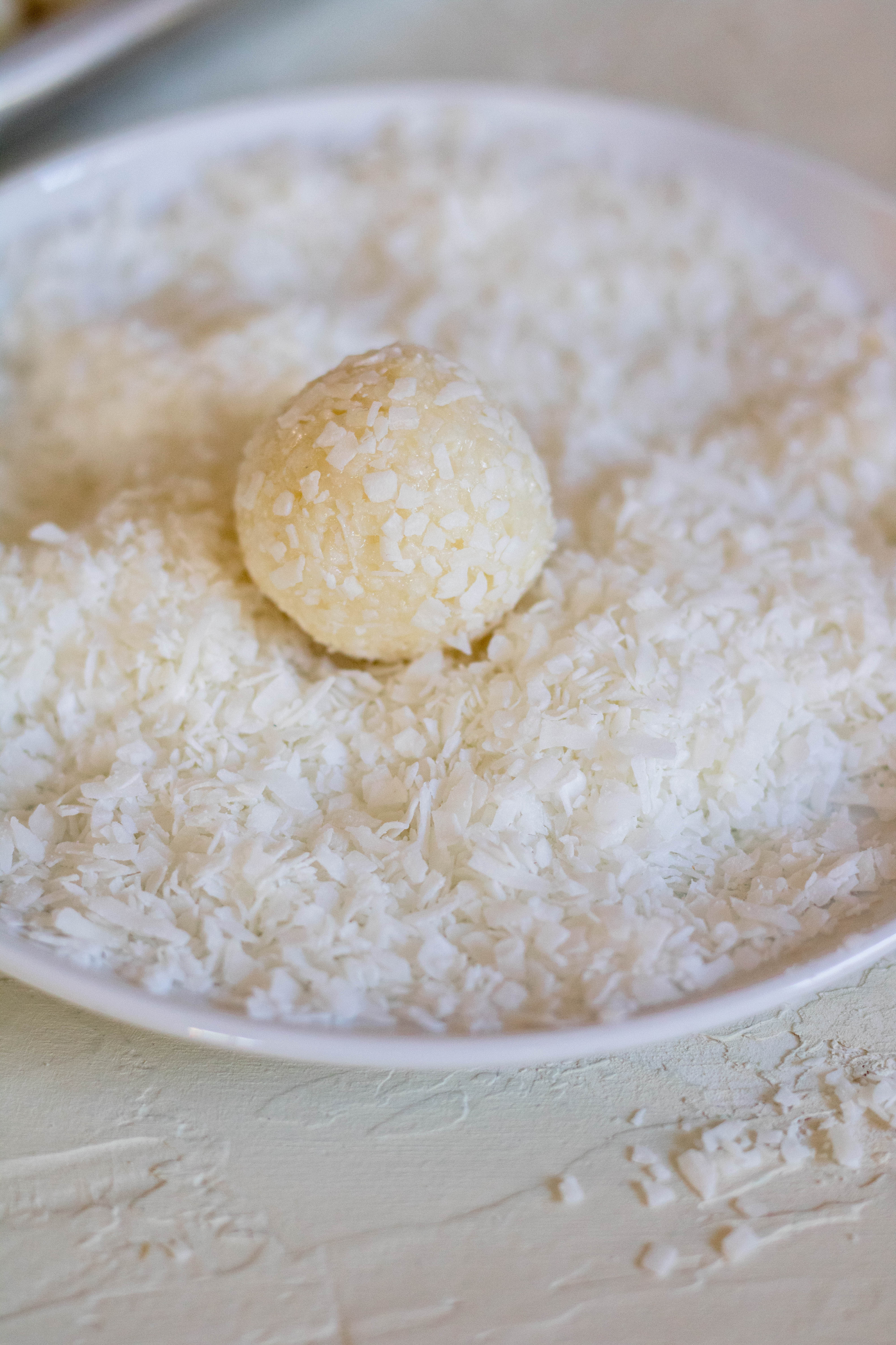 Coating the coconut balls with shredded coconut
