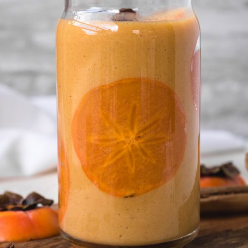 easy persimmon smoothie with a thin slice of persimmon inside