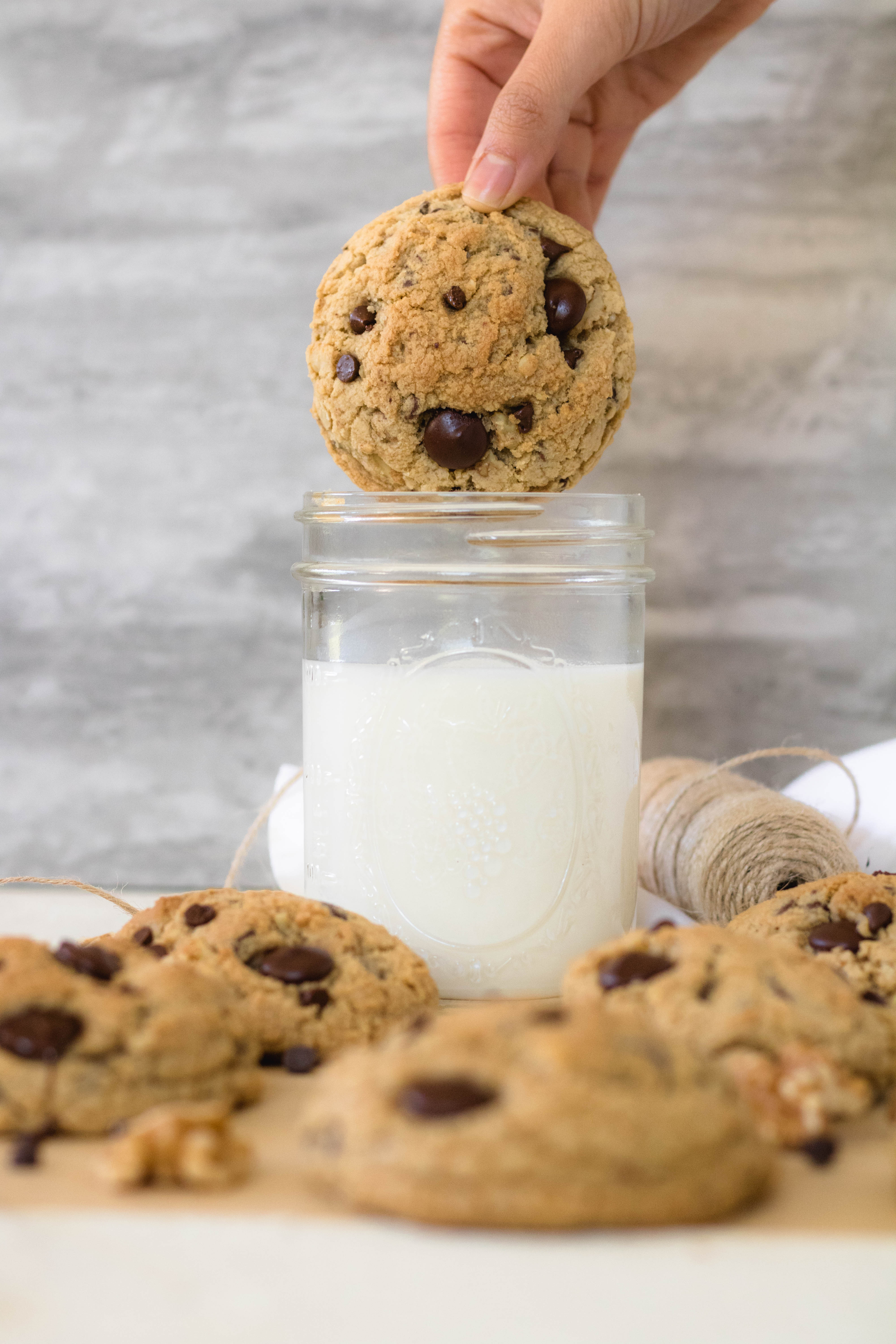 Dunking a chocolate chip cookie in a glass of milk