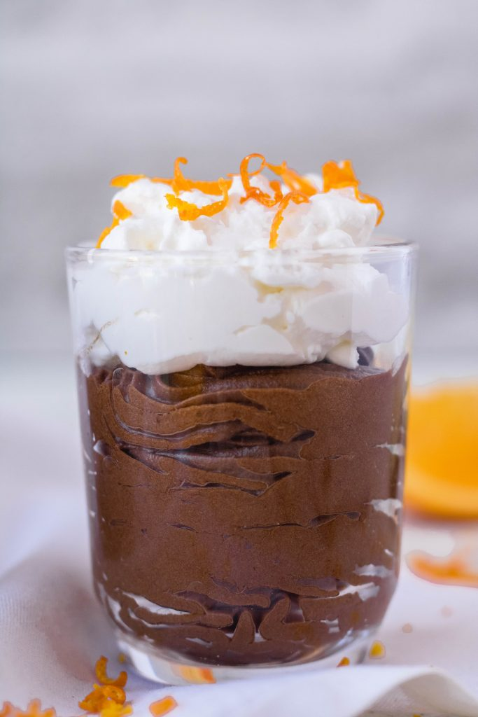 mini glass container with chocolate avocado orange mousse