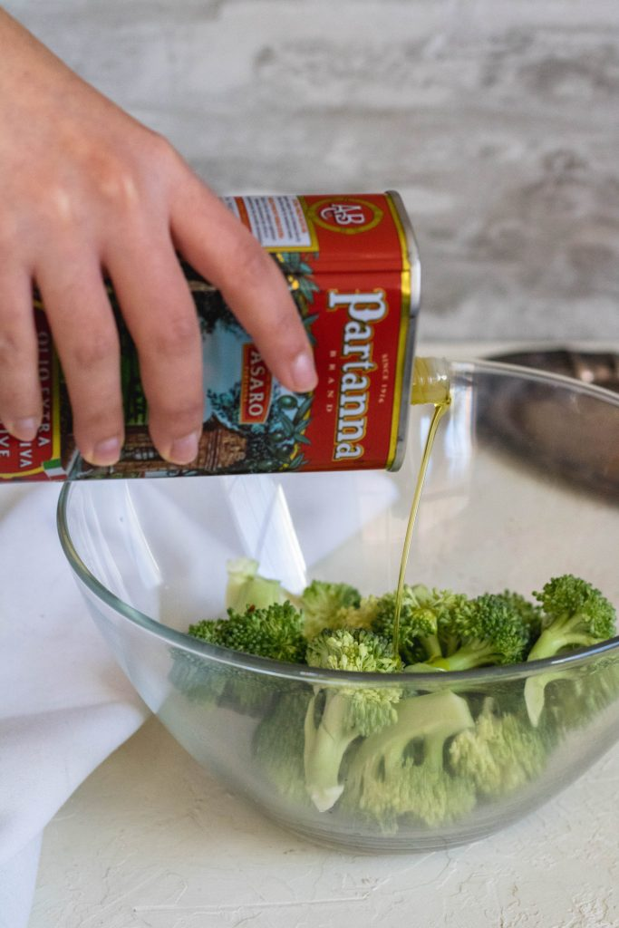 Partanna olive oil poured over broccoli florets