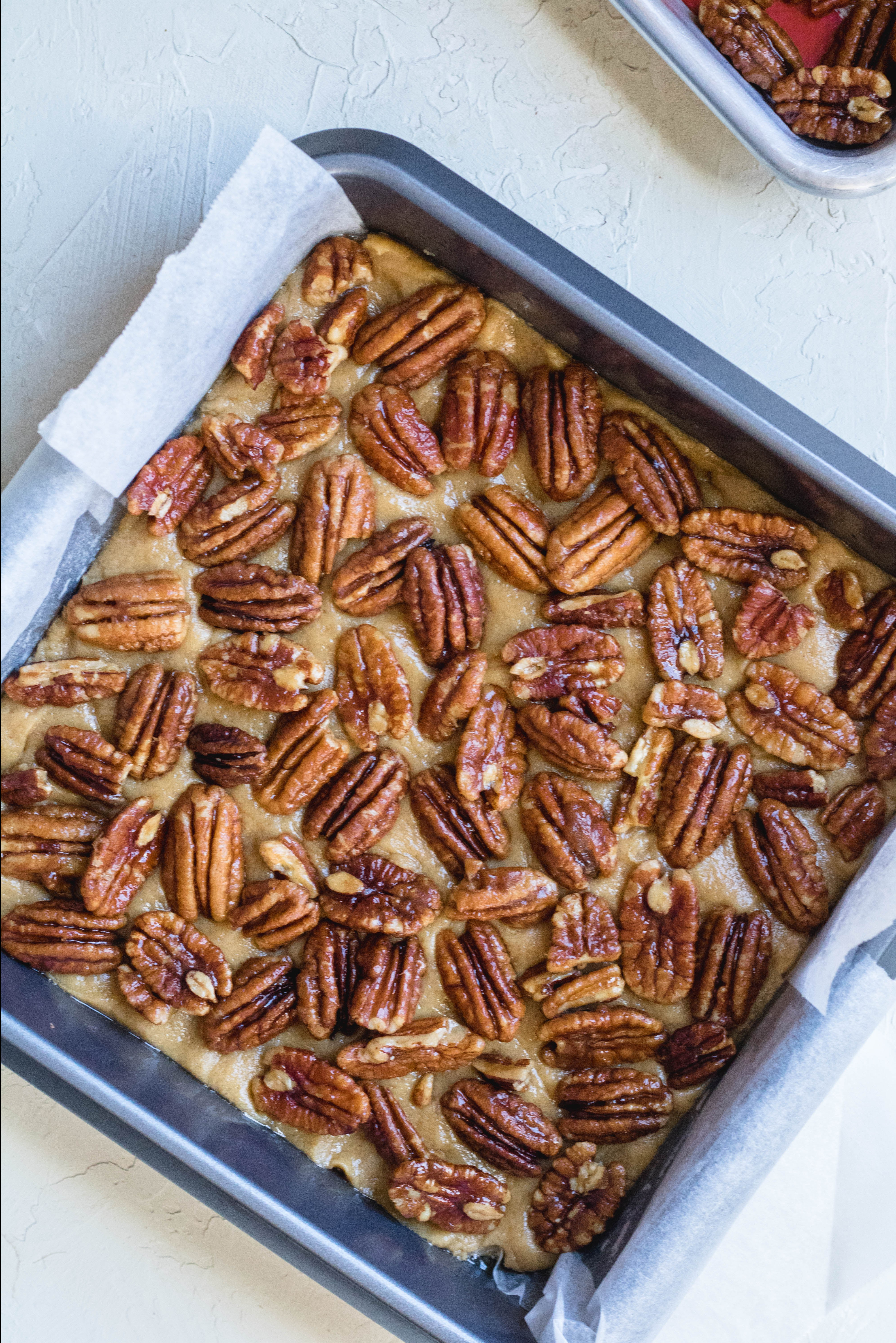 brown butter blondie dough with pecans on top
