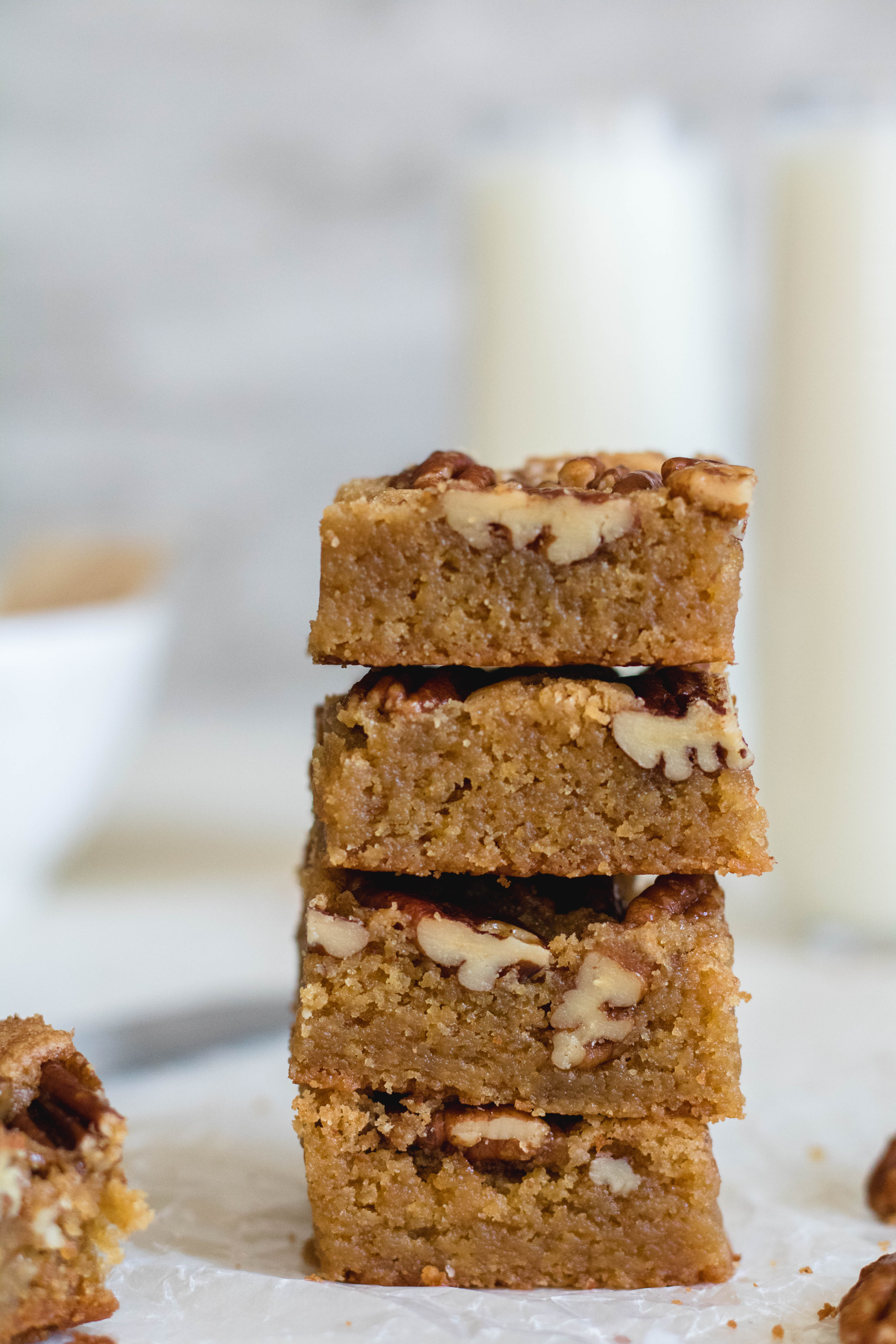 Brown butter pecan blondies stacked on each other