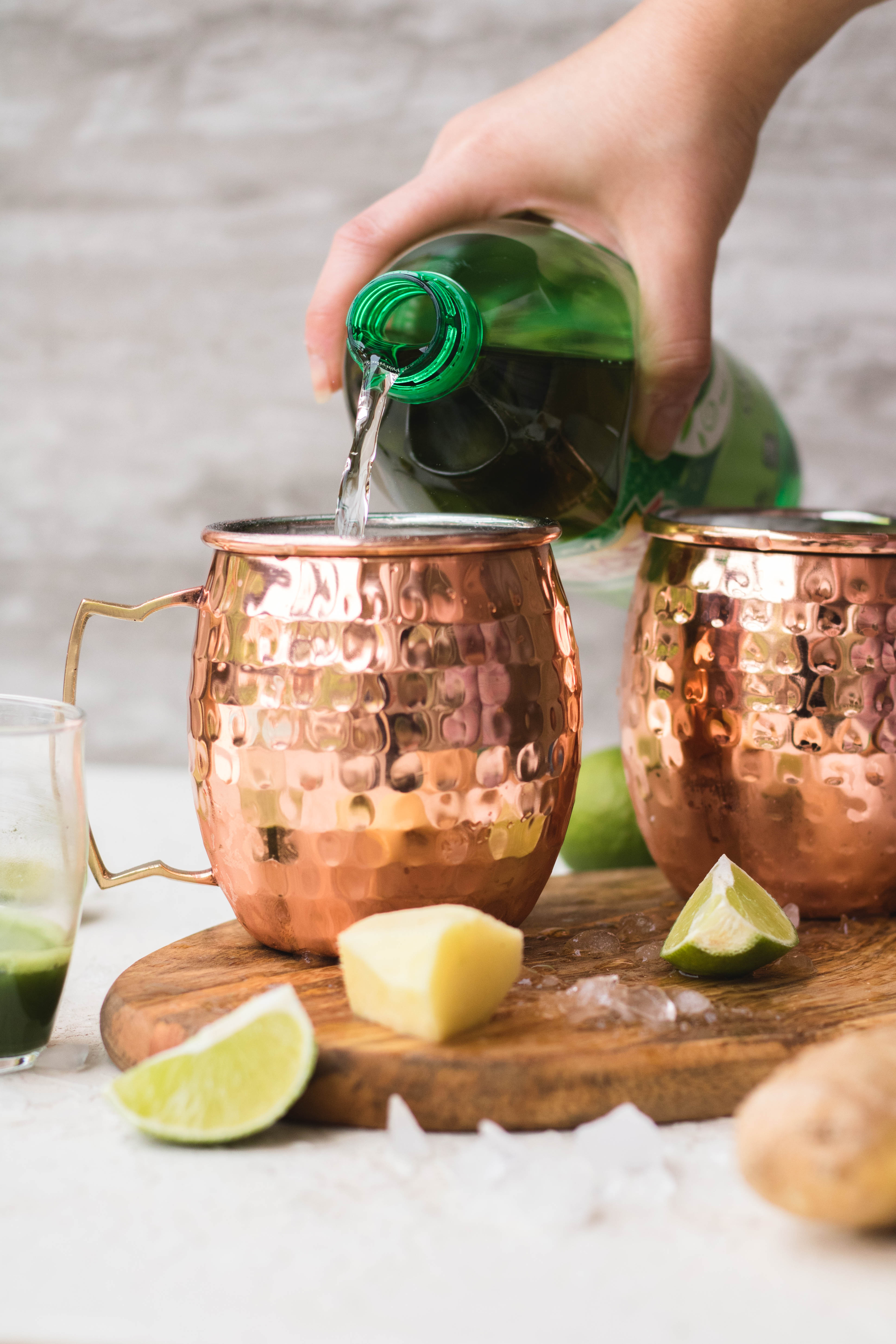 Pouring ginger ale in Moscow mules