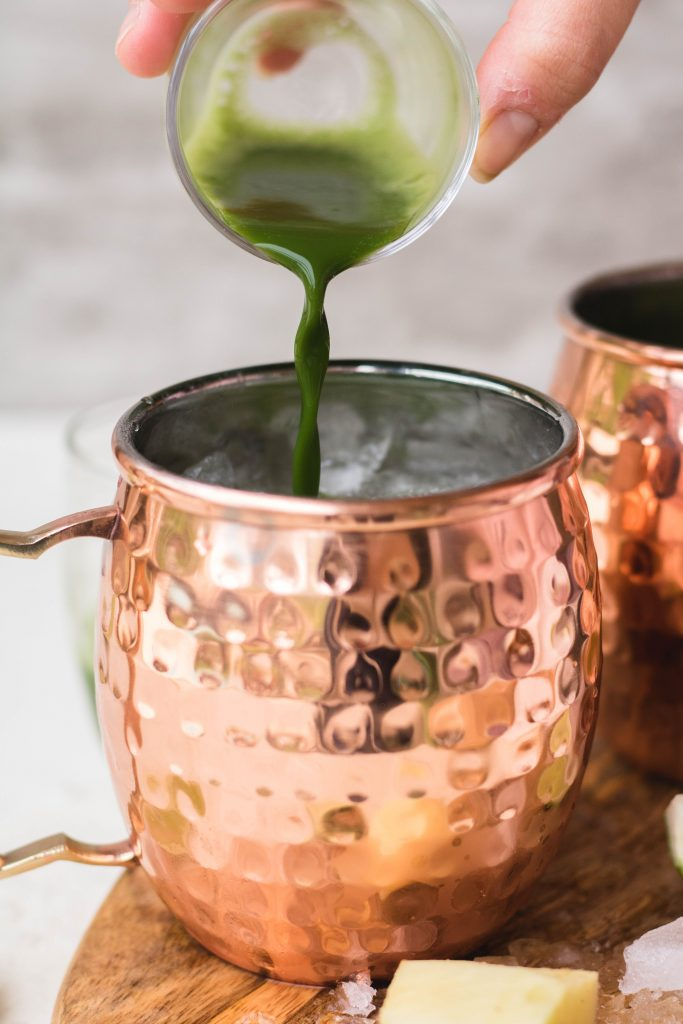Pouring matcha in Moscow mule