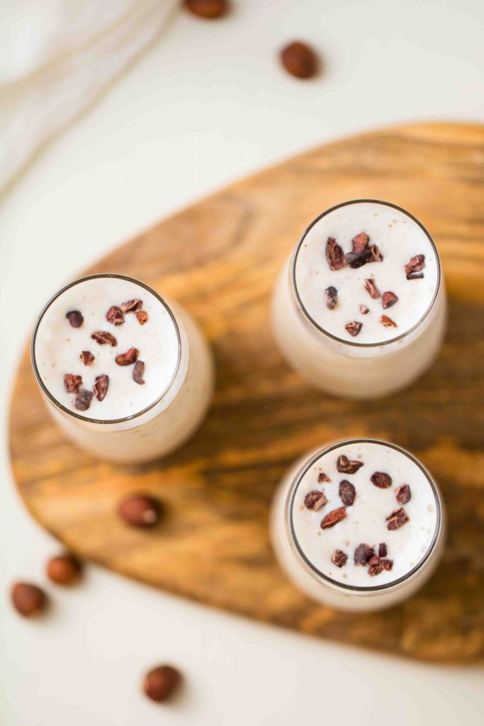 banana hazelnut smoothie with cacao nibs on top