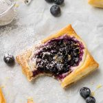 blueberry cheese danish with a bite on the edge