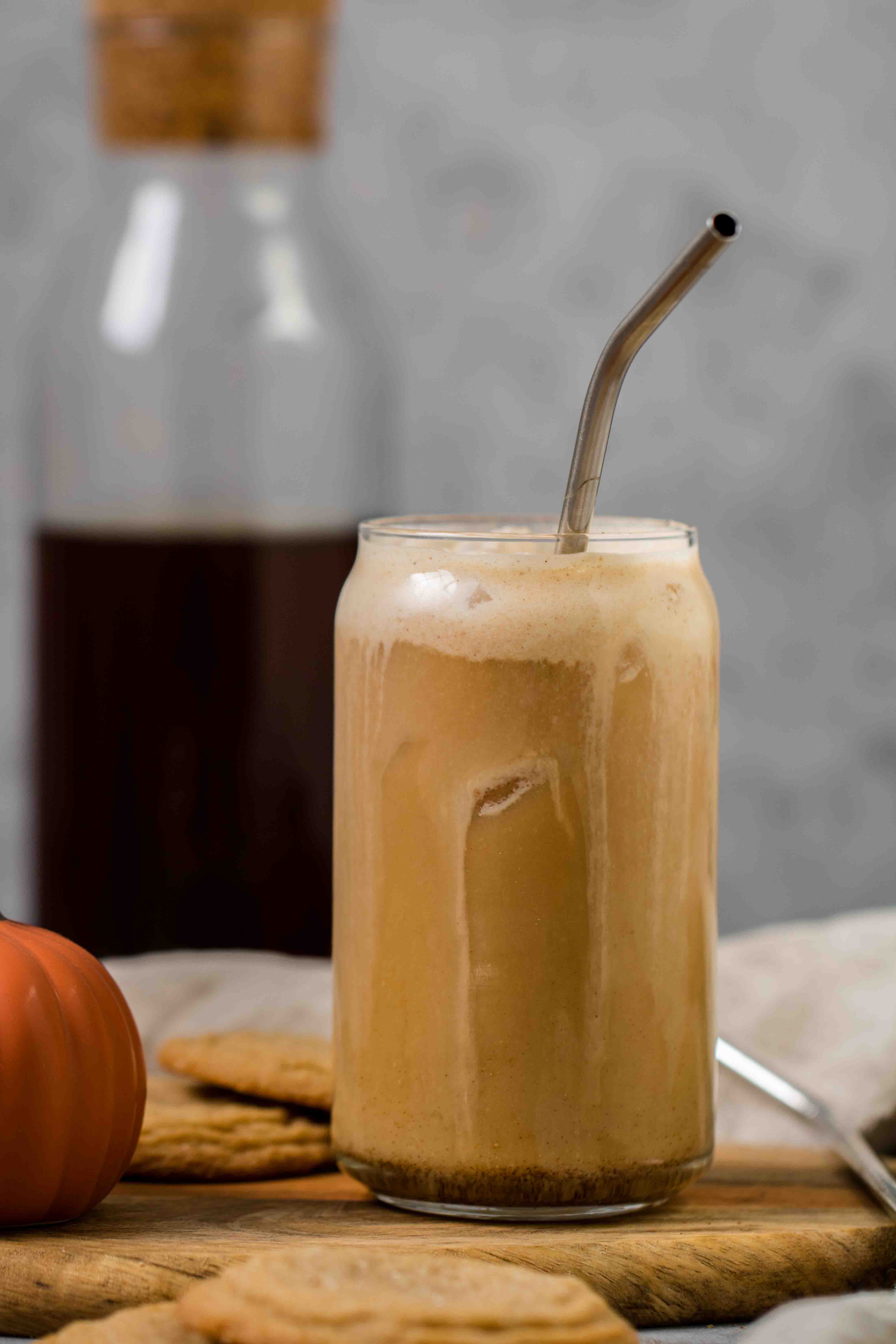 Iced coffee with pumpkin cream mixed in it