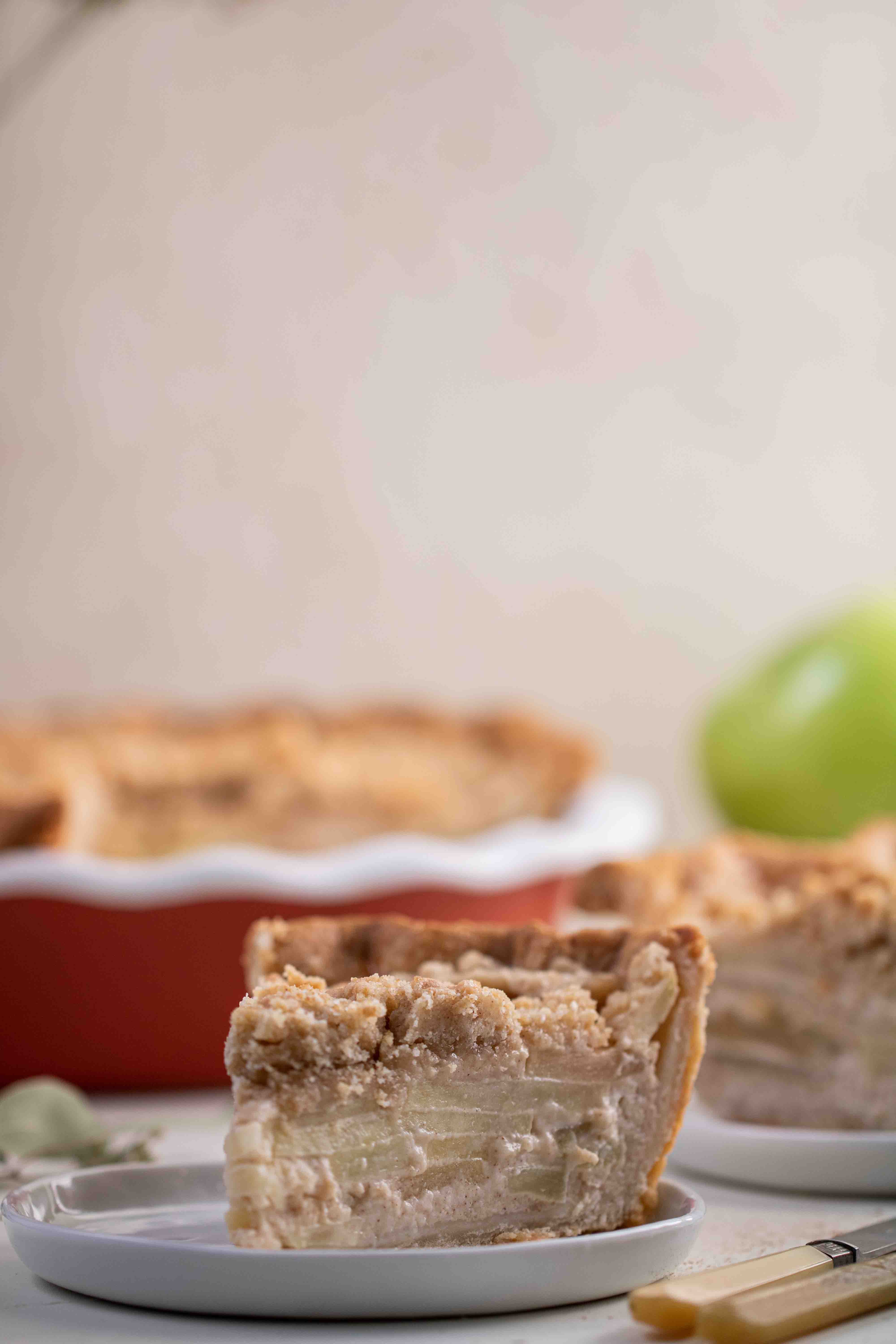 Straight on shot of apple pie showing the texture of each slice