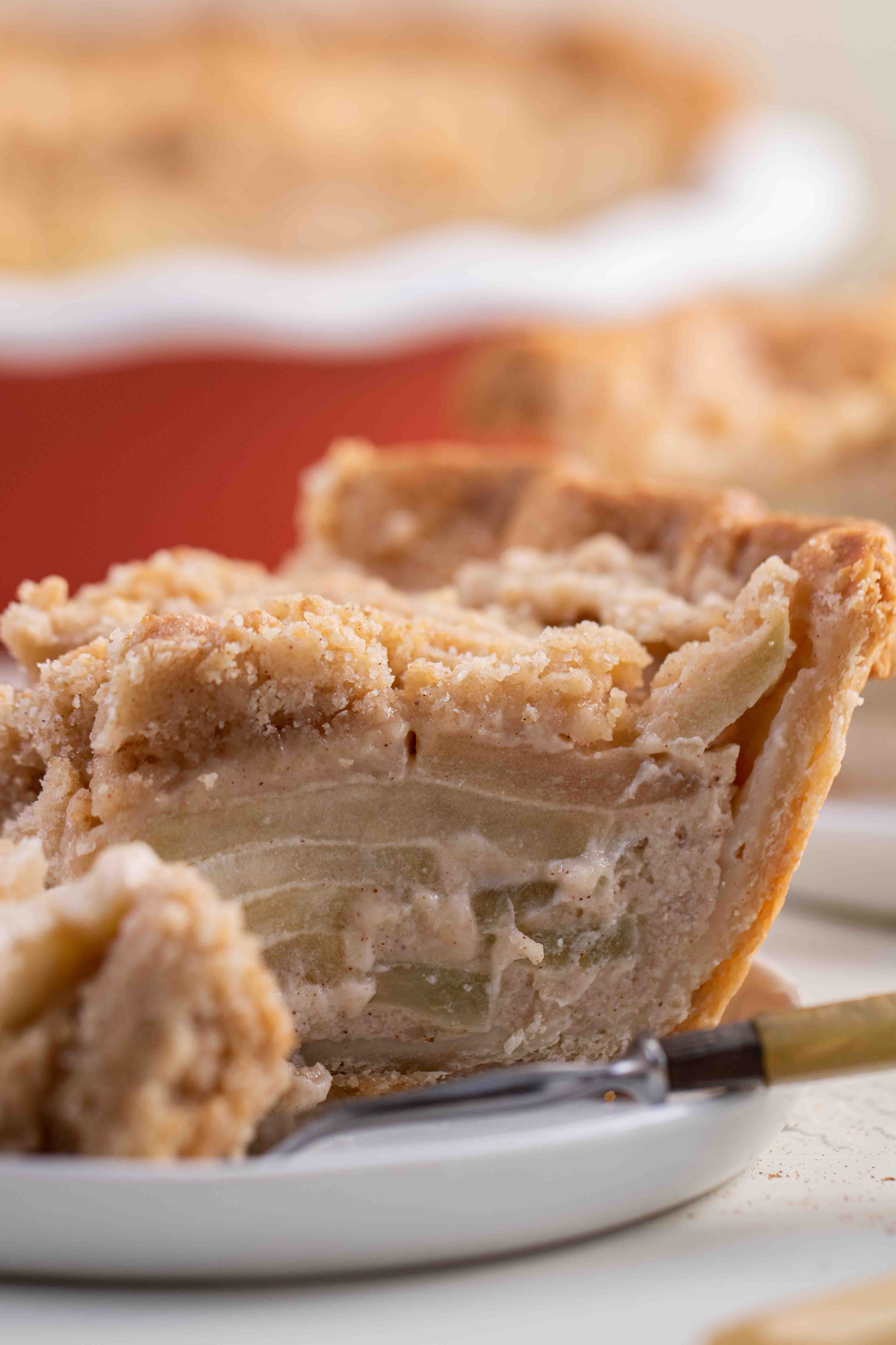 Dutch apple pie with thin apples cooked in between buttery crust and a crumbly topping