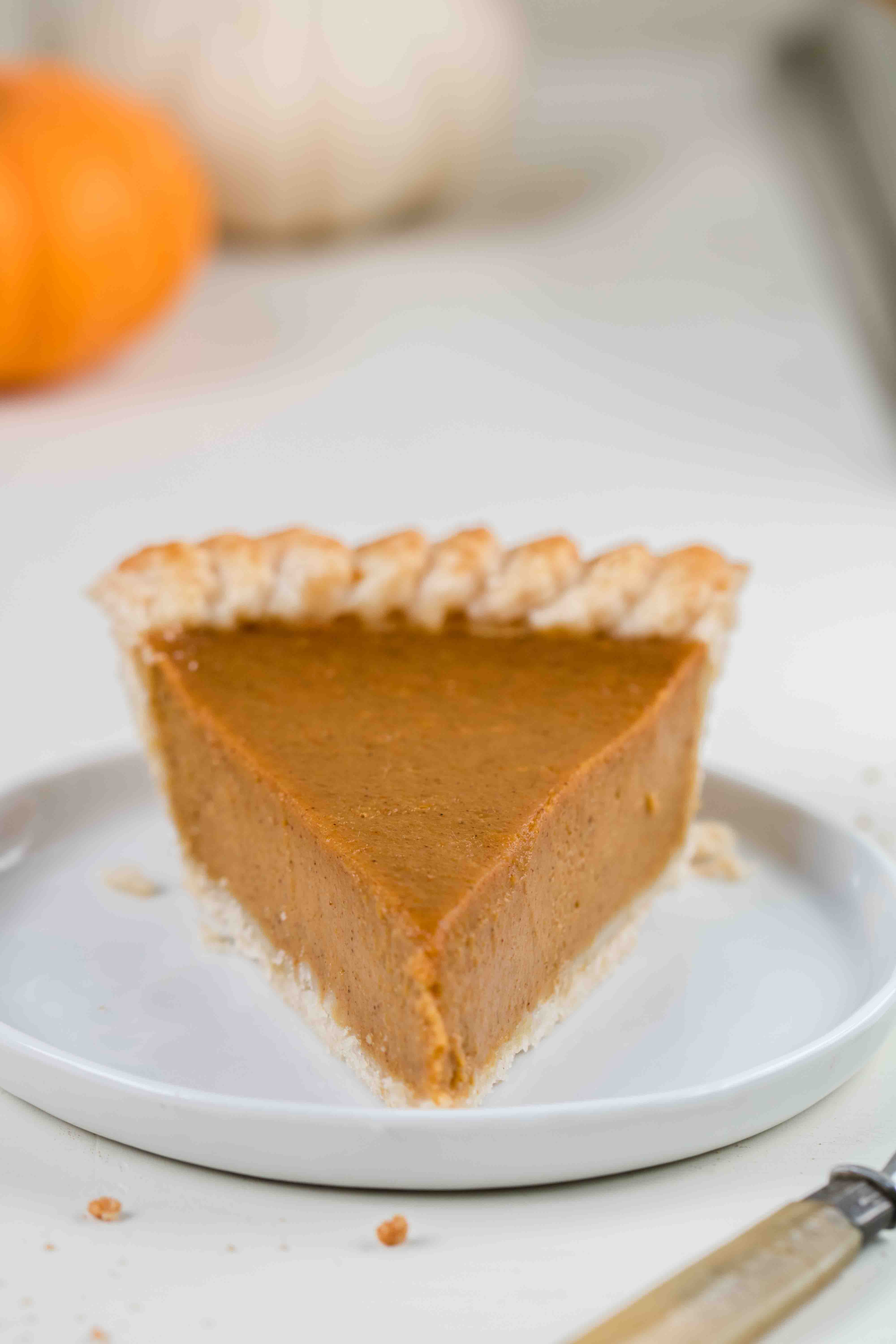 Single pumpkin pie slice with no topping