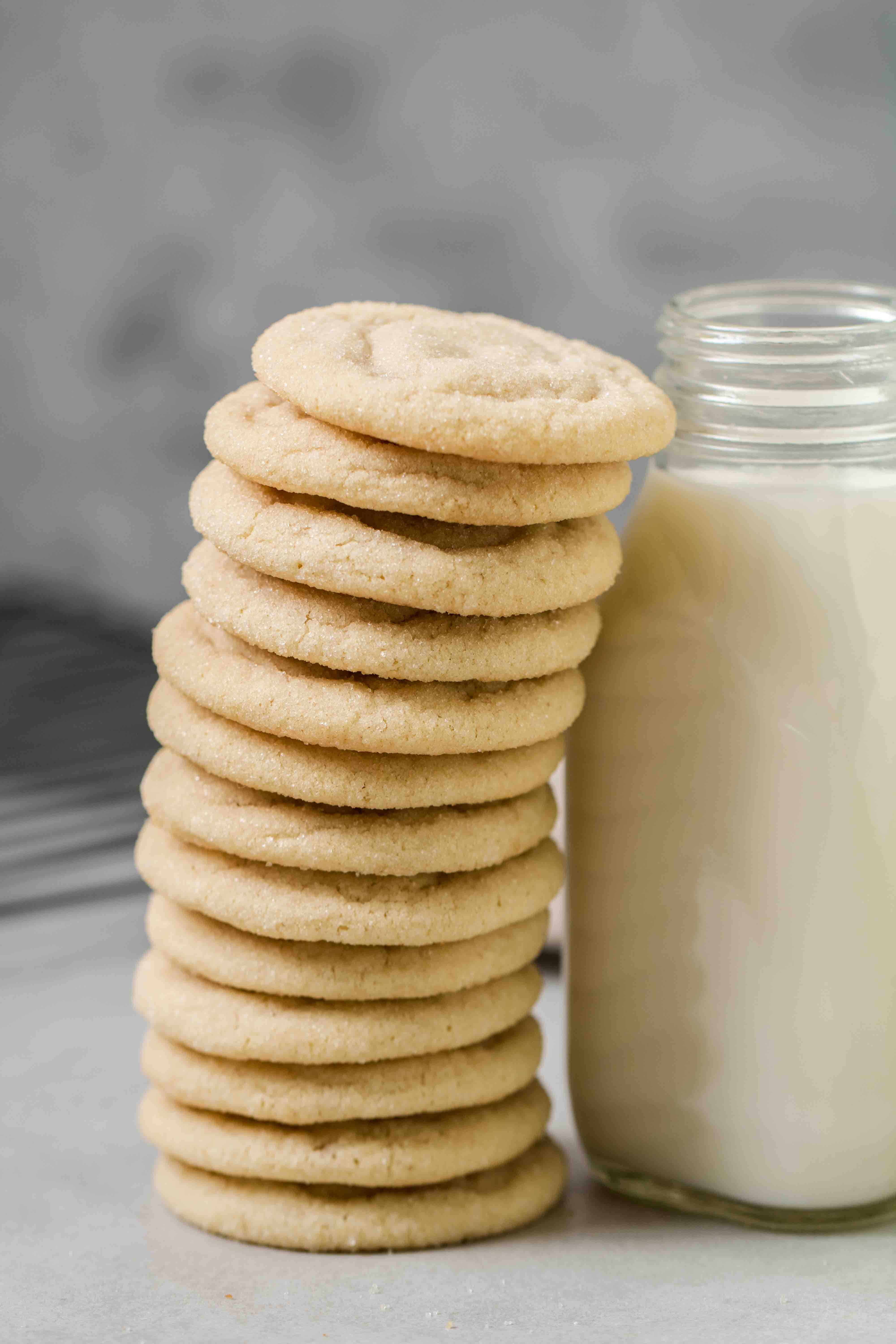 Soft sugar cookies stacked against bottle of milk