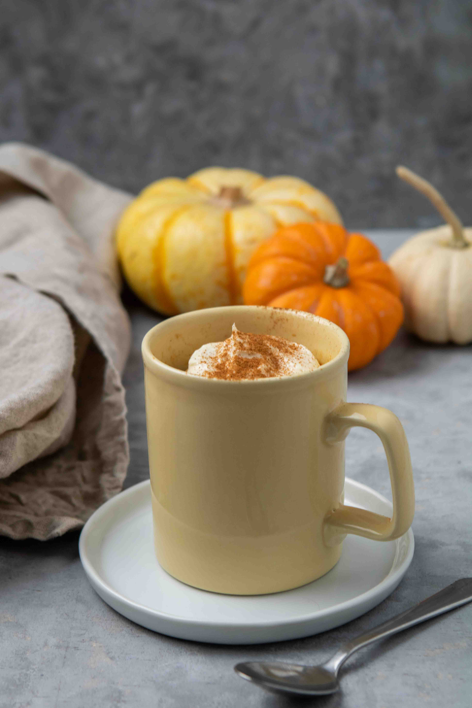 Close up of the pumpkin cake in a yellow mug