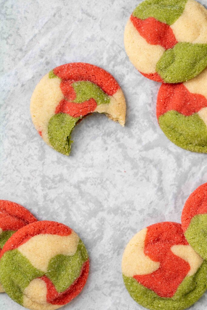 overhead shot of Christmas sugar cookies with one bit