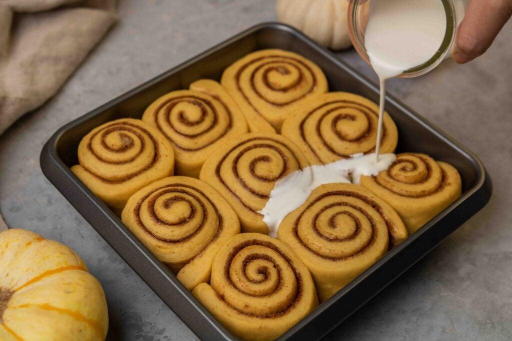 Add heavy cream to cinnamon rolls