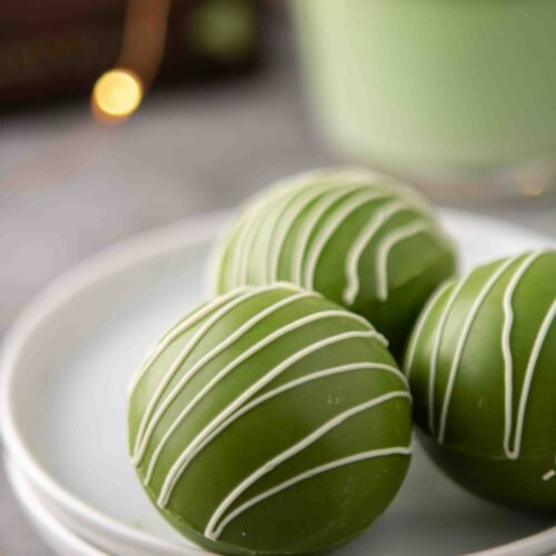 Close up of white hot chocolate green tea bombs