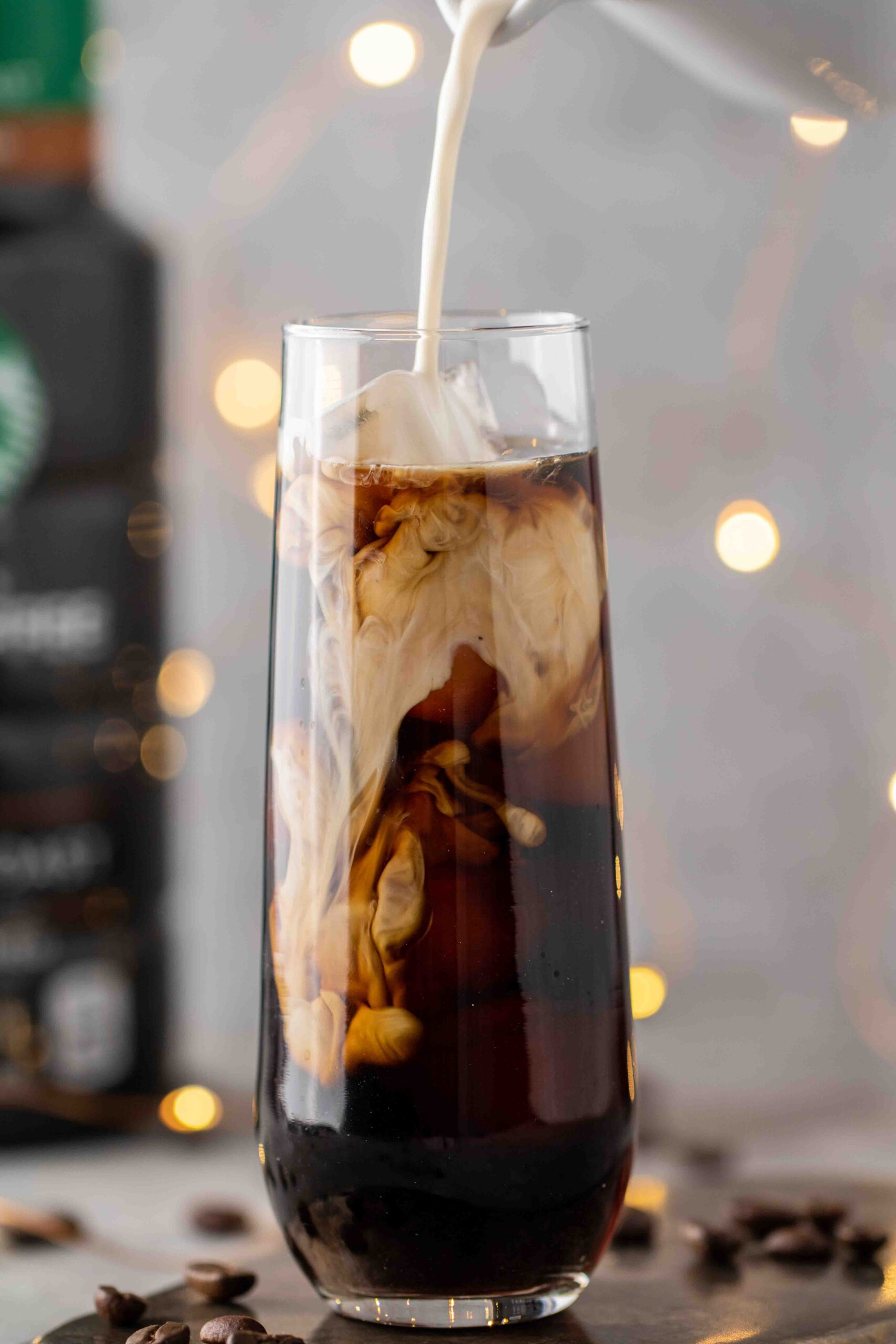 Pouring-sweet-cream-over-cold-brew