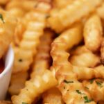 Close up of crunchy air fryer frozen crinkle fries