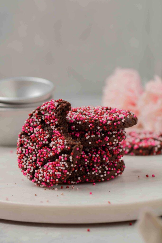 Stack of pink pink sprinkle chocolate cookies