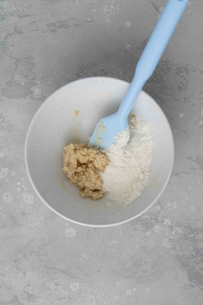 Adding flour to creamed butter mixture