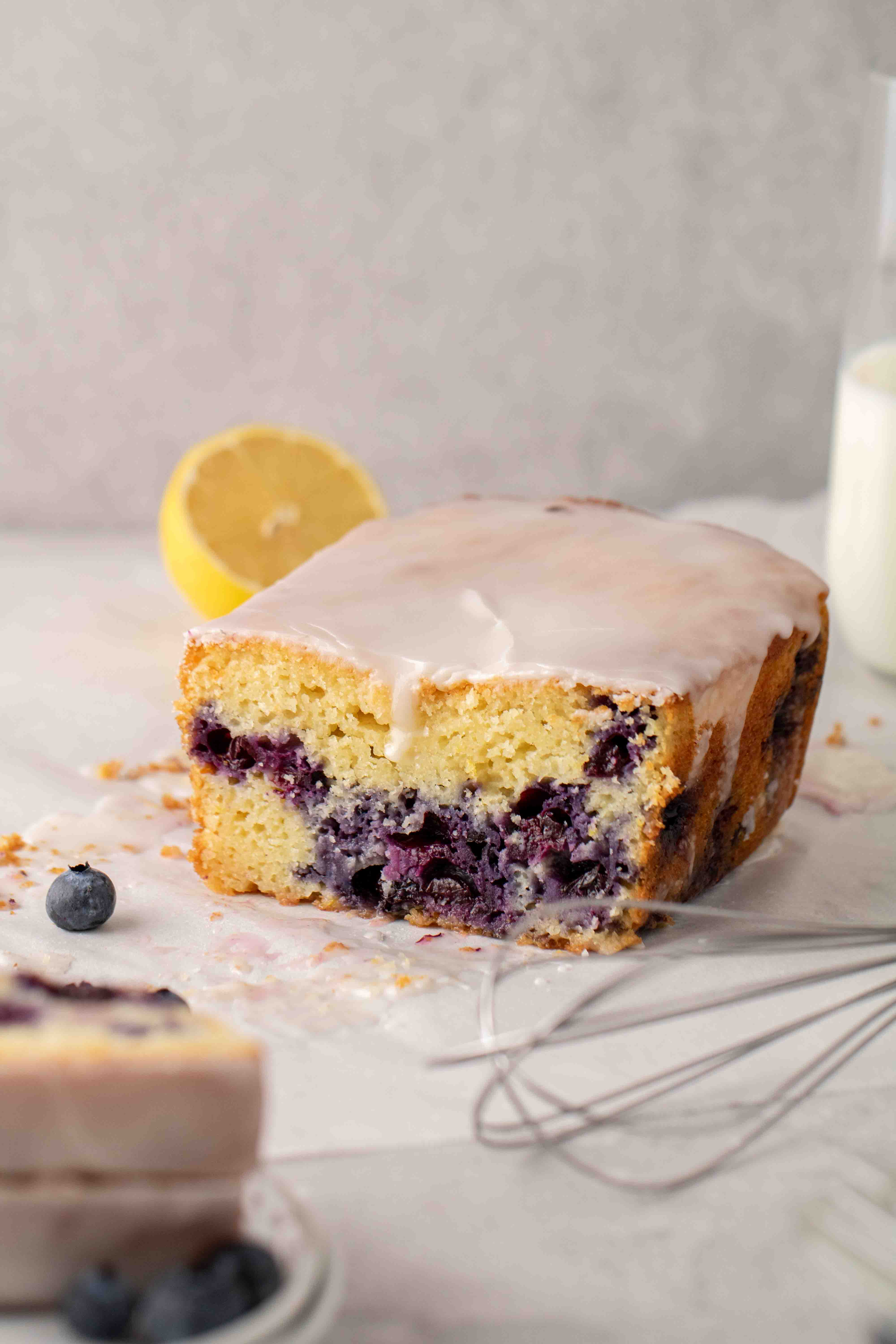 Sliced loaf cake with blueberries and lemon