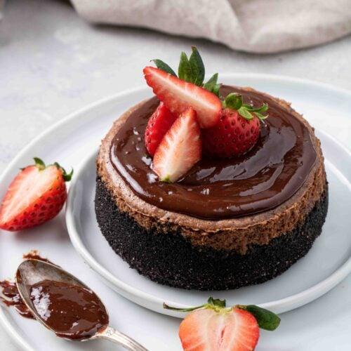 Chocolate cheesecake with chocolate ganache and strawberry on top