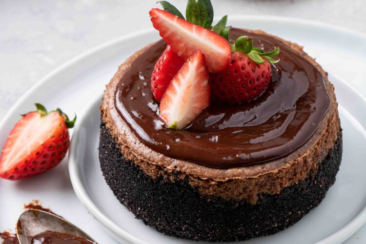 Chocolate cheesecake with chocolate ganache and strawberry on top