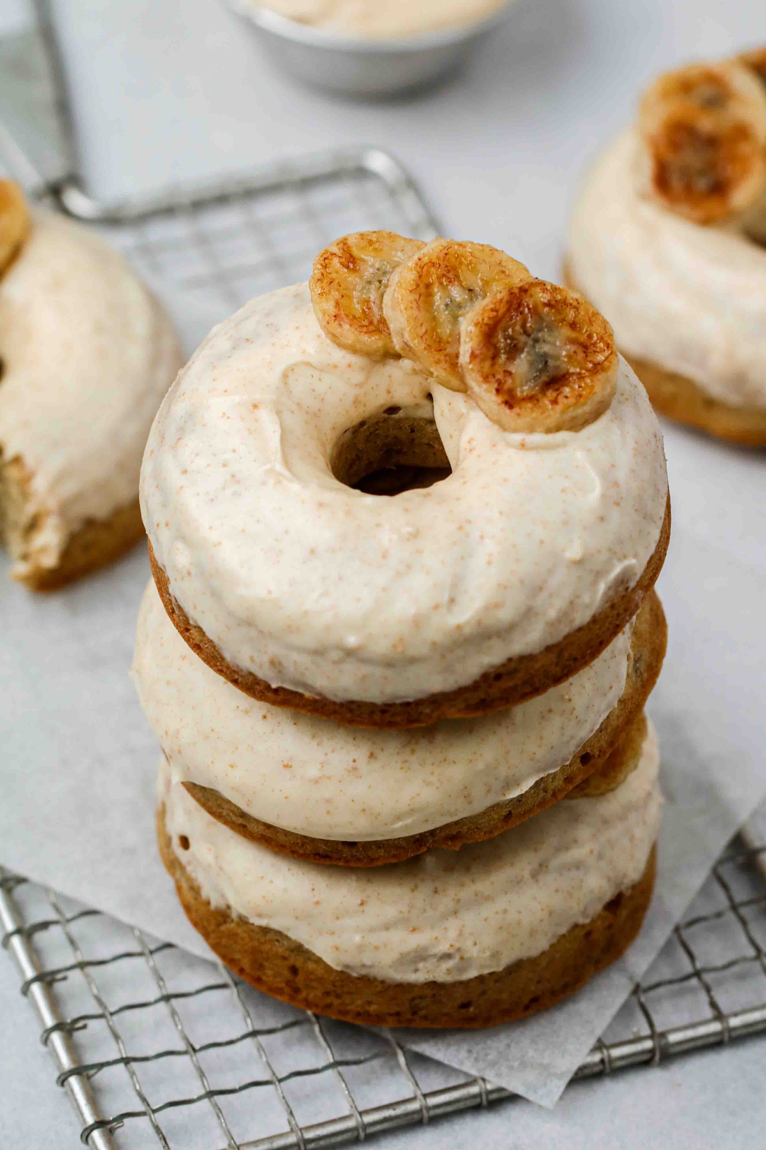 Stack of banana donuts with brown butter glaze