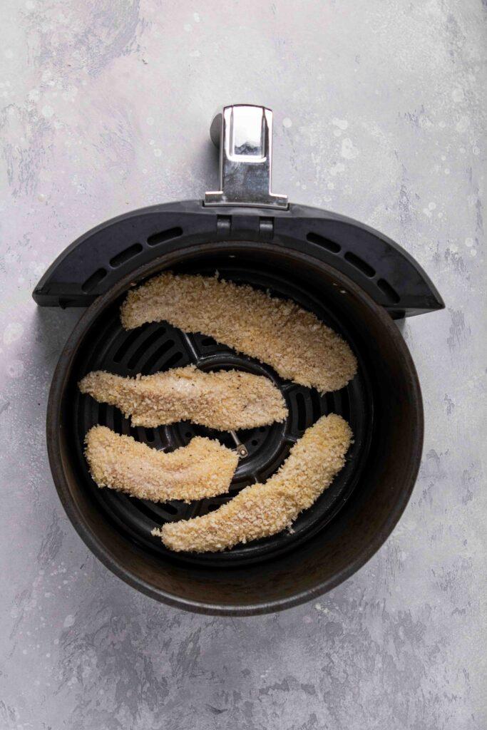 Chicken tenders in the air fryer basket