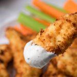 Air fryer chicken tenders dipped in ranch