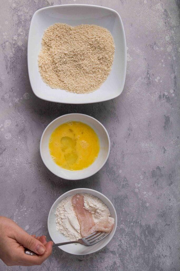 Coat the chicken tenders in flour