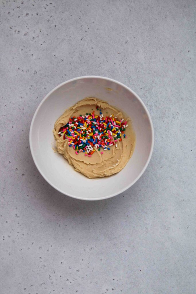 Add the sprinkles to the cookie dough