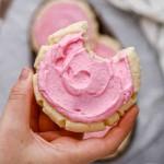 Hand holding CRUMBL sugar cookies