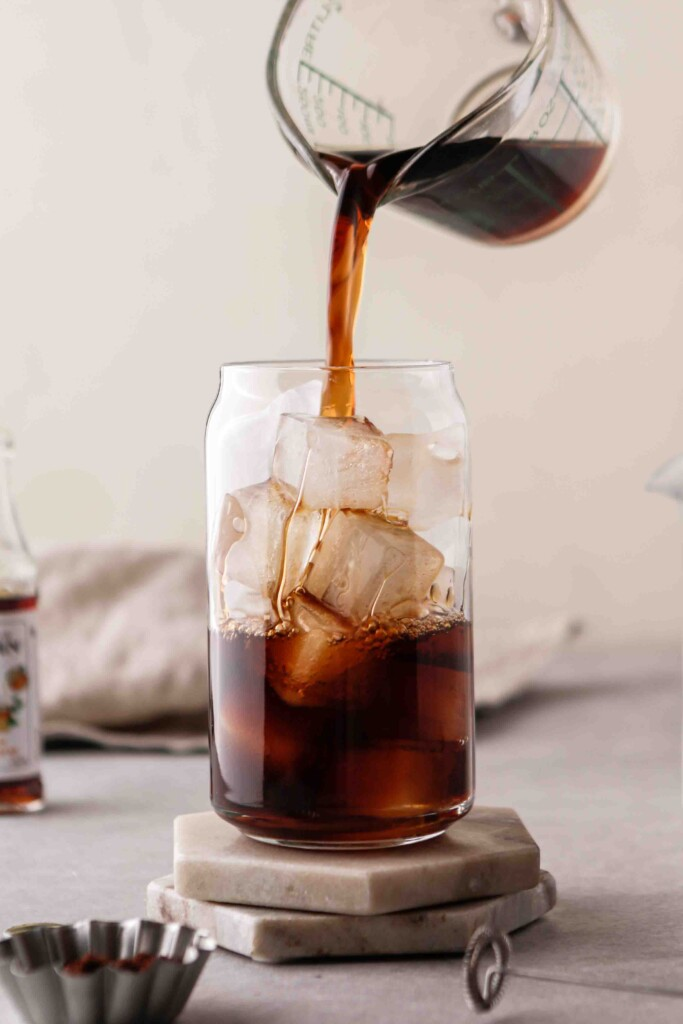 Pour the coffee over ice