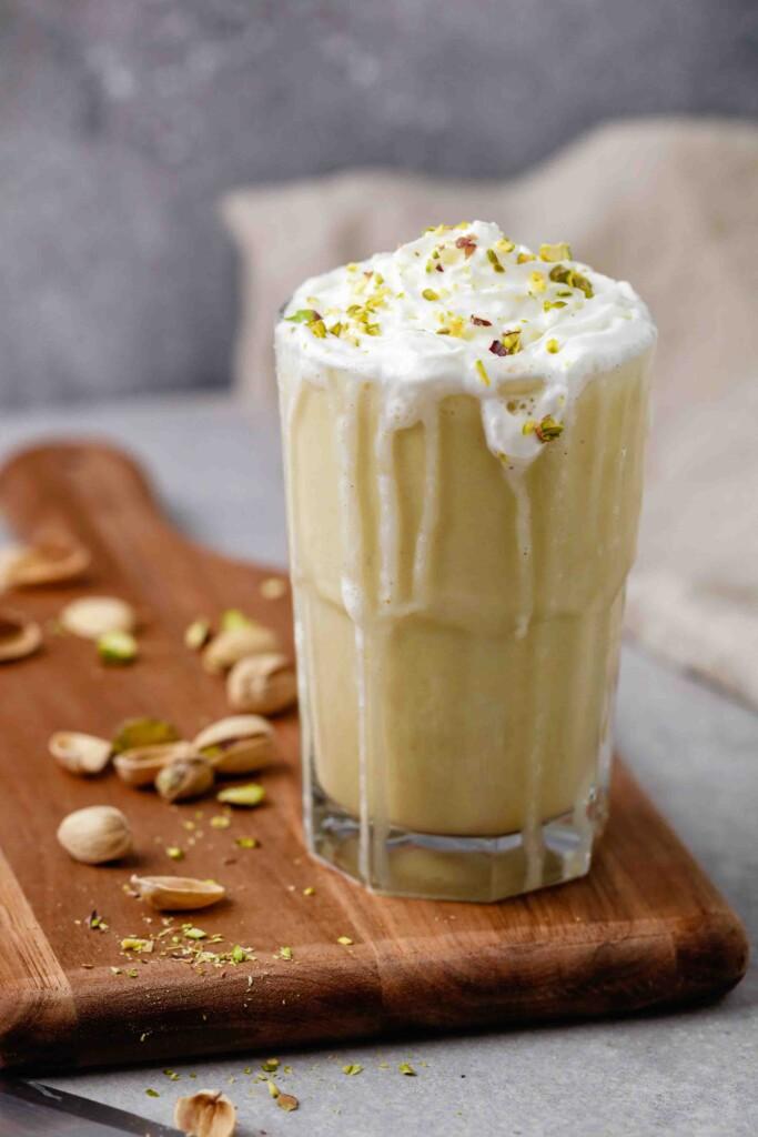 Starbucks pistachio frappuccino on cutting board