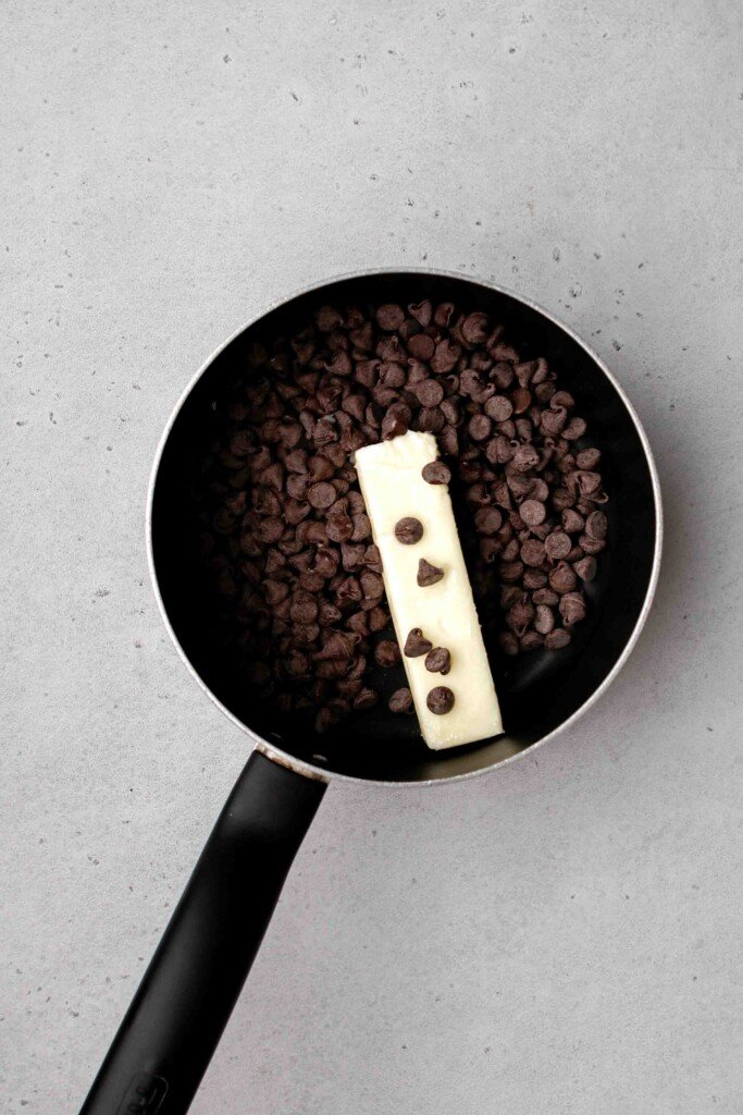 Melt the butter and chocolate chips in a sauce pan