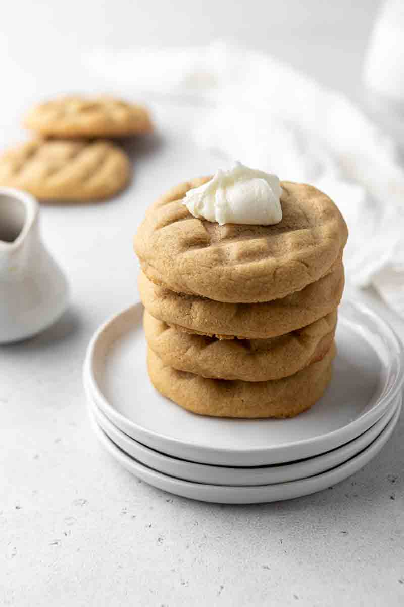 Stack of waffle cookies with a dollop of buttercream