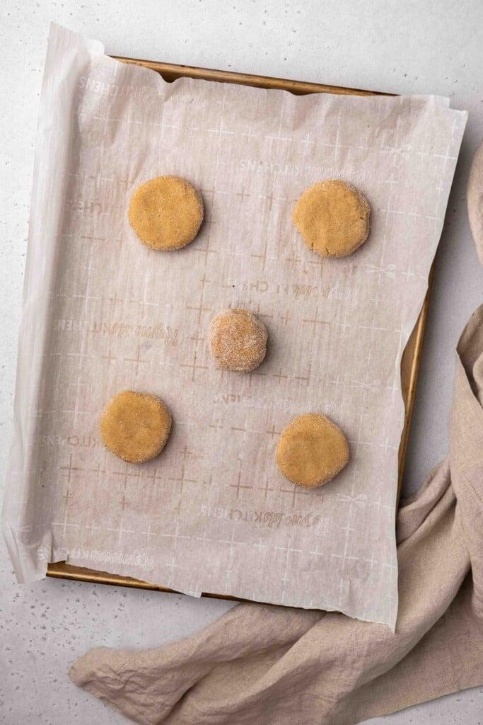 Cinnamon sugar cookie dough balls on baking sheet
