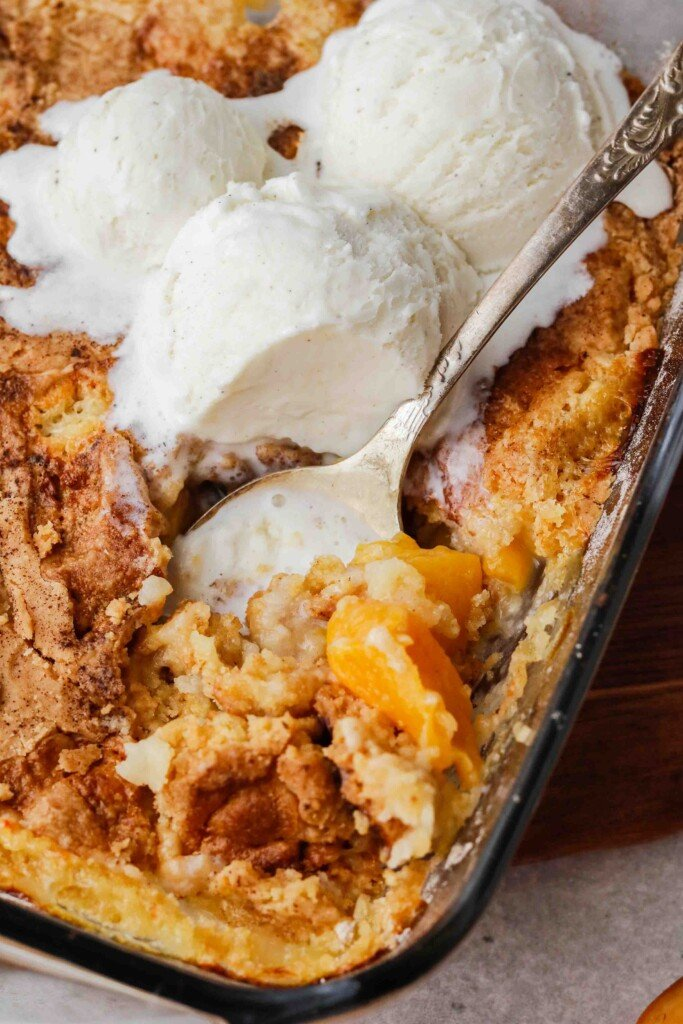 Close up of spoon in peach cobbler
