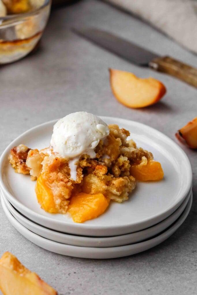 Peach cobbler with ice cream on top