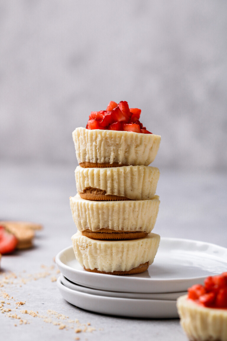 Mini cheesecake cupcake stacked on top of each other