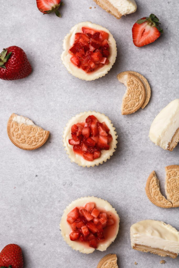 OVerhead shot of small batch mini cheesecakes with strawberry topping
